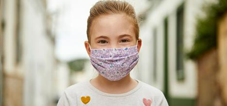 young girl with hand made face mask